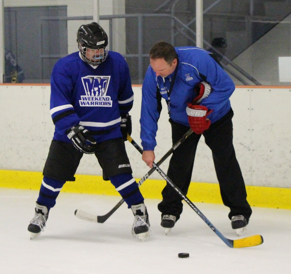 Coach Nate helps a player with stick handling