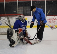 Coach Nick with the goalies